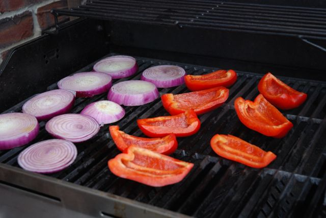 grilled vegetables red pepper and onion on grill