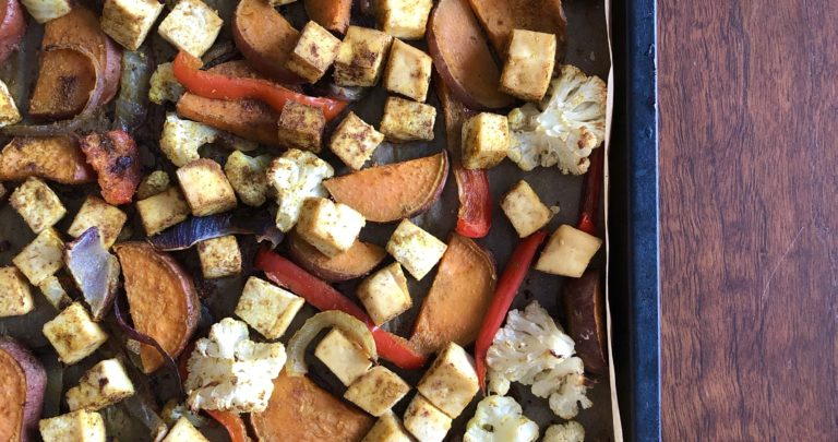 Curried Tofu and Sweet Potato Sheet Pan Meal with Yogurt Tahini Sauce